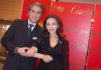 Director of Rome's Cartier Boutique Roberto Grandis and Maria Rosaria Omaggio at the 2009 Cartier Love Day in Rome.