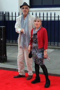 Roger Lloyd Pack and guest at the press night for