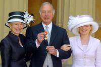 Geoffrey Palmer, his wife Sally and daughter Harriet at the Buckingham Palace.