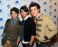 Nick Jonas, Joe Jonas and Kevin Jonas at the book launch for