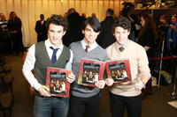 Kevin Jonas, Joe Jonas and Nick Jonas at the book launch for