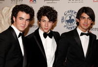 Kevin Jonas, Nick Jonas and Joe Jonas at the 30th anniversary Carousel of Hope Ball to benefit the Barbara Davis center for childhood diabetes.