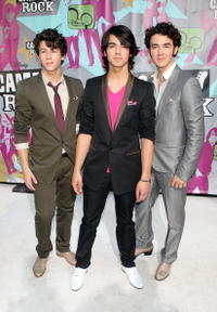Nick Jonas, Joe Jonas and Kevin Jonas at the premiere of
