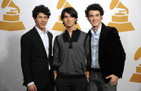 Nick Jonas, Joe Jonas and Kevin Jonas at the nominations announcement for the 51st Grammy Awards.