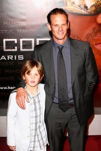 Peter Berg and Guest at the premiere of