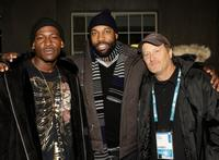 Producer Baron Davis, Stacy Peralta and Guest at the premiere of