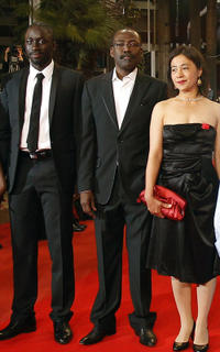 Diouc Koma, director Mahamat-Saleh Haroun and Heling Li at the premiere of