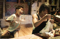 Xu Jiao as Dicky Chow and Stephen Chow as Ti Chow in