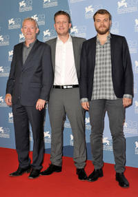 Soren Malling, director Tobias Lindholm and Pilou Asbaek at the photocall of