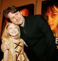 John Polson and Dakota Fanning at the premiere of