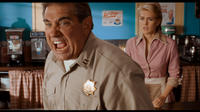 Dan Lauria as Officer Dawson and Jenni Baird as Tammy in