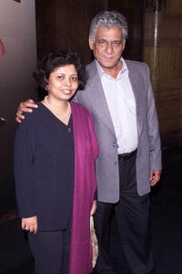 Om Puri and his wife at the premiere of