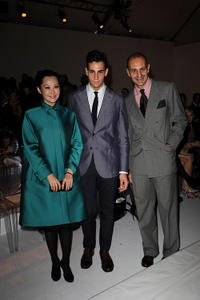 Xu Qing, Guest and Luigi Maramotti at the Max Mara Spring/Summer 2011 fashion show during the Milan Fashion Week.