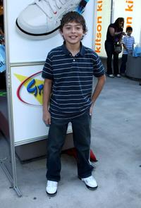 Ryan Ochoa at the re-opening of Kitson Kids Robertson Location.