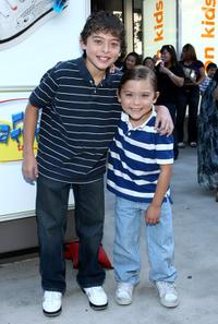 Ryan Ochoa and Raymond Ochoa at the re-opening of Kitson Kids Robertson Location.