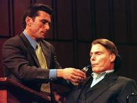 Christopher Reeve is assisted as he testifies during a hearing on stem cell research.