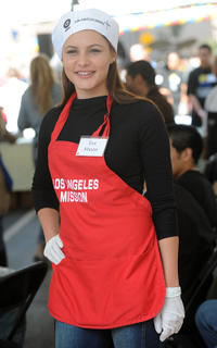 Eve Mauro at the Los Angeles Mission to help serve the free Easter dinner to the needy and homeless, in downtown Los Angeles.