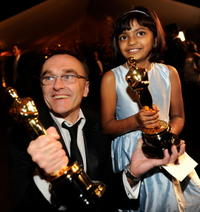 Director Danny Boyle and Rubina Ali at the 81st Annual Academy Awards.