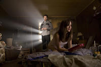Kerr Smith as Axel Palmer and Megan Boone as Megan in