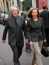 Jean Rochefort and his wife arrive at the funeral of Jean-Claude Brialy.