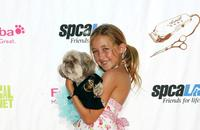 Noah Cyrus at the grand opening party for the Artist Knox Luxury Grooming Pet Salon.