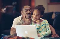 Eddie Murphy as Evan Danielson and Yara Shahidi as Olivia Danielson in