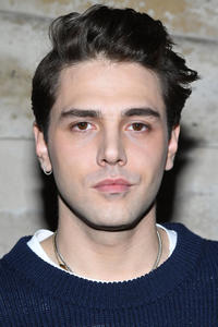 Xavier Dolan at the Louis Vuitton Show during Paris Fashion Week.