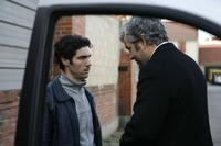Tahar Rahim as Malik and Pierre Leccia as Sampierro in
