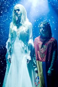 Sheri Moon Zombie as Deborah Myers and Chase Vanek as Michael Myers in