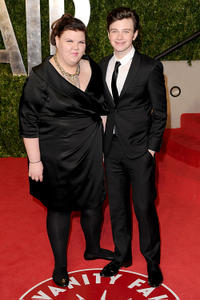 Ashley Fink and Chris Colfer at the 2011 Vanity Fair Oscar party in California.