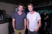 Liam Hemsworth and Chris Hemsworth at the Oakley party in Utah.