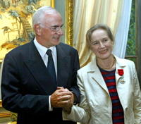 Dominique Sanda and Francis Lott at the end of the ceremony during which Sanda was decorated with the Legion D'Honneur.