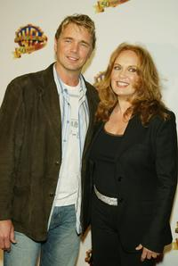 John Schneider and Catherine Bach at the Warner Bros. TV and Warner Home Video's 50 Years of Quality TV celebration.