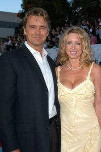 John Schneider and Elly Castle at the premiere of