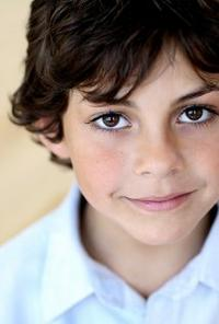 Headshot of Emjay Anthony.
