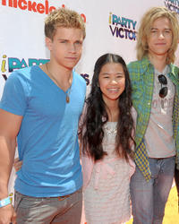 Glenn McCuen, Tiffany Espensen and Dillon Lane at the Orange Carpet of the Los Angeles premiere of
