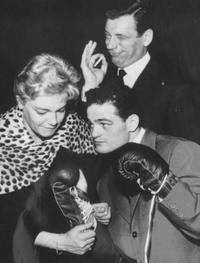 Simone Signoret, her husband Yves Montand and Alphonse Halimi picture taken at the fight against Joe Beccera for the Bantamweight World Championships title.