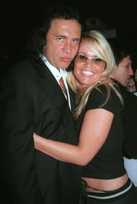 Gene Simmons and Guest at the Tongue Magazine Fall 2002 Issue release party.