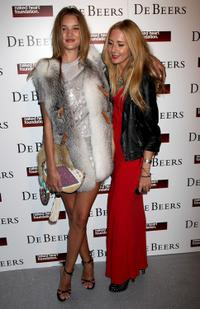 Rosie Huntington-Whiteley and Guest at the Love Ball London.