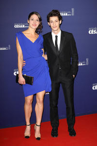 Pierre Niney and Guest at the 37th Cesar Film Awards in France.