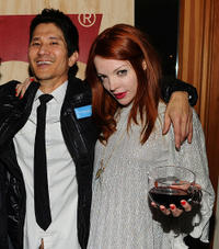 director Gregg Araki and Nicole LaLiberte at the Cocktail Reception of