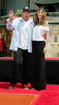 Adam Sandler and Jackie Sandler at the Foot and Hand Print Ceremony in California.
