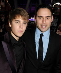 Singer Justin Bieber and Scooter Braun at the California premiere of