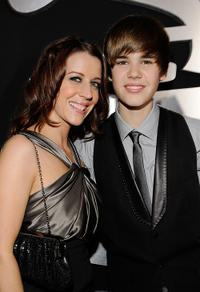Pattie Mallette and Musician Justin Bieber at the 52nd Annual GRAMMY Awards in California.