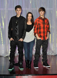 Musician Justin Bieber and Pattie Mallette at the Unveils Justin Bieber Waxwork at Madame Tussauds in London.