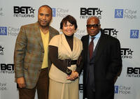 Attorney Londell McMillan, Chairman and CEO of BET Debra Lee and L.A. Reid at the City Of Hope's Music and Entertainment Industry presents