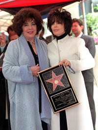 Elizabeth Taylor and Carole Bayer Sager at the Sager's ceremony in California.