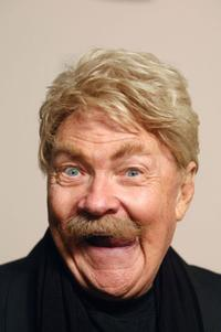 Rip Taylor poses at the premiere of