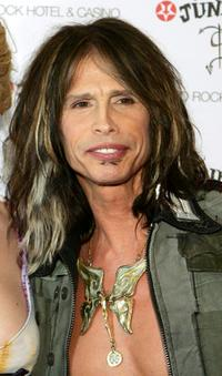 Steven Tyler at the dedication ceremony for a display case of this stage clothing.