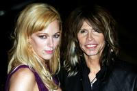 Steven Tyler and guest at the BRIT Awards.